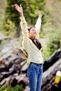 Girl raising hands in praise